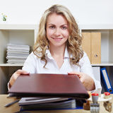 Smiling woman offering application Royalty Free Stock Image