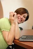 Smiling woman at the office desk Stock Photos