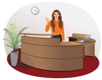 Smiling woman at office reception Stock Photo