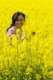 Smiling woman in oil seed field royalty free stock image