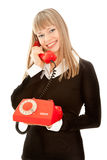 Smiling woman with old telephone Royalty Free Stock Photo