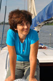 Smiling woman on old yacht Stock Photography