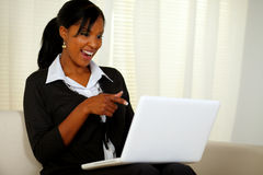 Free Smiling Woman On Black Suit Pointing To Laptop Stock Photo - 26090830