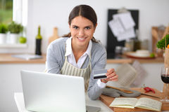 Smiling woman online shopping using computer and Stock Photo