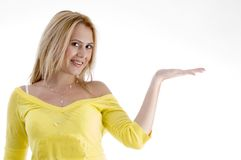 Smiling woman with open palm Royalty Free Stock Photography