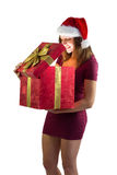 Smiling woman opening christmas present Stock Image