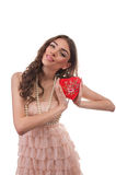 Smiling woman opening heart shaped gift box on Valentine's Day Stock Photos