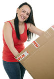 Smiling woman opening a parcel Royalty Free Stock Photography