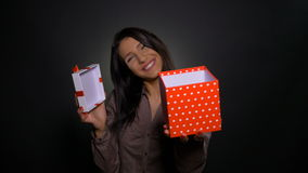 Smiling woman opens a surprise gift box and offers it to birthday celebrated. Smiling woman opens surprise gift box and offers it to birthday celebrated stock video
