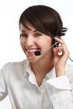 Smiling woman operator with headset. Joyful woman operator with headset - microphone and headphones, on white stock image