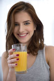 Smiling woman with orange juice Royalty Free Stock Images