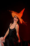Smiling woman in orange pointed hat Stock Photography