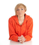 Smiling woman in orange sweatshirt Stock Image