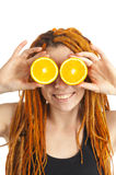 Smiling woman with oranges in her hands Stock Images