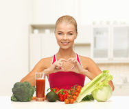 Smiling woman with organic food Royalty Free Stock Photo
