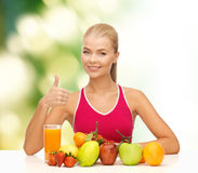 Smiling woman with organic food or fruits on table Royalty Free Stock Images
