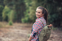 Smiling woman out for a hike in the forest Royalty Free Stock Image