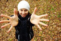 Smiling woman outdoor. Happy girl with hands up outdoors Stock Photography