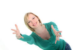 Smiling woman with outstretched arms. Beautiful smiling young woman with outstretched arms waiting to welcome you into her embrace isolated on white Royalty Free Stock Photo
