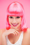 Smiling woman over pink background. Young woman over pink background Stock Photo