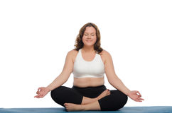 Smiling woman with overweight practices yoga Royalty Free Stock Images