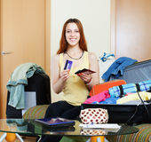 Smiling woman and packing suitcase Royalty Free Stock Photo