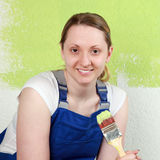 Smiling woman with paintbrush Stock Photo
