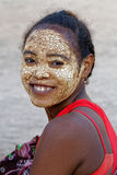 Smiling woman with painted face Royalty Free Stock Images