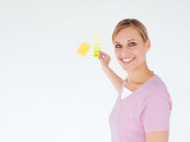 Smiling woman painting a room. Looking at the camera Royalty Free Stock Photos