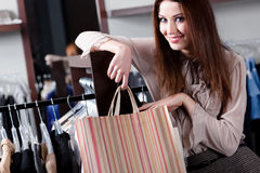 Smiling woman with paper bags Royalty Free Stock Image