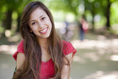 Smiling woman in park Stock Images