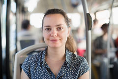 Smiling woman passenger sitting in public bus Royalty Free Stock Photos