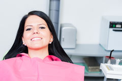 Smiling woman patient at dentist with copy space Royalty Free Stock Image