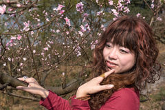 Smiling woman and Peach Flower Stock Photos