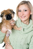 Smiling woman with a pekinese Stock Images