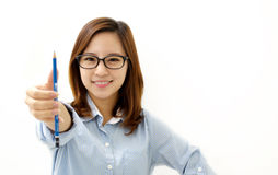 Smiling woman with a pen Stock Photos