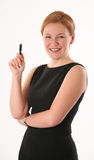 Smiling woman with pen Royalty Free Stock Images