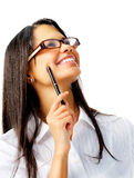 Smiling woman with pen and glasses Stock Images