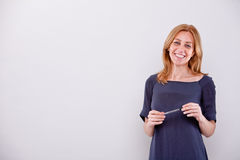 Smiling woman with a pen Royalty Free Stock Images