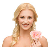 Smiling woman with peony flower Stock Photo