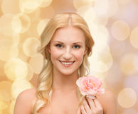 Smiling woman with peony flower Royalty Free Stock Images