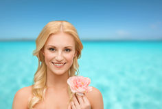 Smiling woman with peony flower Royalty Free Stock Photography