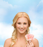 Smiling woman with peony flower Royalty Free Stock Photos