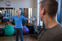 Smiling woman performing exercise with resistance band Stock Image