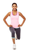 Smiling Woman Performing Stretching Lunge Exercises Royalty Free Stock Images