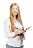 Smiling woman with personal organizer Royalty Free Stock Photos