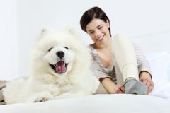 Smiling woman with pet dog Stock Images