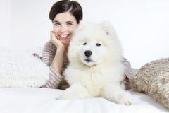 Smiling woman with pet dog Stock Photos