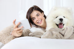 Smiling woman with pet dog. selfie Stock Images