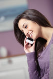 smiling woman on phone Stock Photography